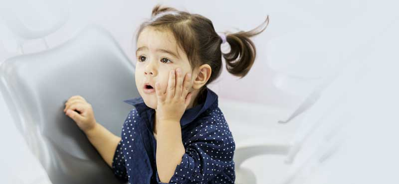 Little Girl with a Toothache