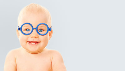 Smiling Baby with Glasses