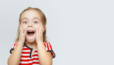 Ecstatic Girl with Tooth Colored Fillings